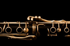 Fragment of clarinet on a black background Stock Photos