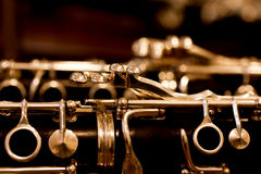 Fragment of the clarinet. In dark colors stock photo