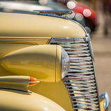 Classic car. Fragment of a classic car showing the nose of the car and the grill Royalty Free Stock Photo