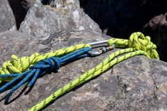 Fragment of climbing rope on rock Stock Images