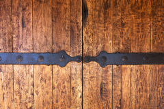 Fragment of closed wooden gate with metal fittings Stock Images