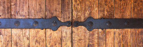 Fragment of closed wooden gate with metal fittings Stock Photos
