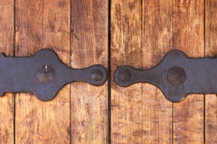 Fragment of closed wooden gate with metal fittings Royalty Free Stock Photo