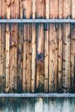 Fragment of closed wooden gate with rusty hinges. Natural wood royalty free stock photos