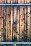 Fragment of closed wooden gate with rusty hinges. Natural wood royalty free stock image
