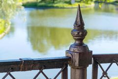 Fragment closeup of an ancient iron fence Royalty Free Stock Photo