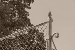 Fragment closeup of color sepia ancient iron fence Royalty Free Stock Photography