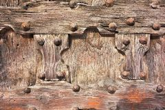 Fragment closeup of an old wooden door or gate Royalty Free Stock Photography