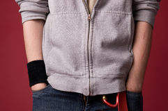 Fragment of clothes young men. Fragment of clothes young men on a red background Royalty Free Stock Images