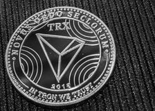 A fragment of the coin cryptocurrency tron. TRX logo. A fragment of the coin cryptocurrency tron closeup. TRX macro royalty free stock image