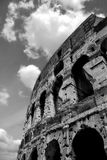 Fragment of Coliseum. Vertical oriented image of famous Coliseum in Rome, Italy (black & white Stock Image