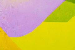 Fragment coloré de mur avec le détail du graffiti, art de rue Couleurs créatives abstraites de mode de dessin Iconique moderne images libres de droits