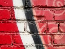 Fragment of colored abstract brick wall paint in red color stock images