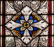 Fragment of colored ornamental glass of window of the church Royalty Free Stock Photos