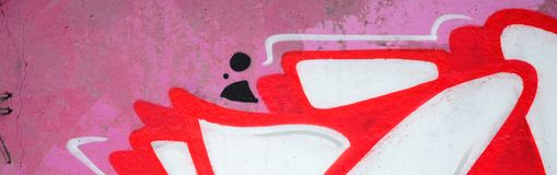 Fragment of colored street art graffiti paintings with contours and shading close up. Background texture of youth contemporary art culture. Pink red and black royalty free stock photography