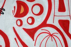 Fragment of colored street art graffiti paintings with contours and shading close up. Background texture of youth contemporary art culture. Orange, red and royalty free stock photos