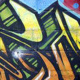 Fragment of colored street art graffiti paintings with contours and shading close up. Background texture of youth contemporary art culture. Yellow orange and stock images