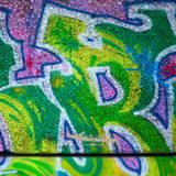 Fragment of colored street art graffiti paintings with contours and shading close up. Background texture of youth contemporary art culture. Green and yellow stock images