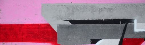 Fragment of colored street art graffiti paintings with contours and shading close up. Background texture of youth contemporary art culture. Pink red and black stock photography