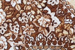 Fragment of colorful retro tapestry textile pattern with floral ornament useful as background.  Stock Images