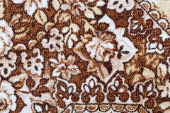 Fragment of colorful retro tapestry textile pattern with floral ornament useful as background Royalty Free Stock Photo