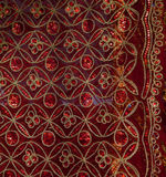 Fragment of colorful retro tapestry textile pattern with floral ornament useful as background Royalty Free Stock Images