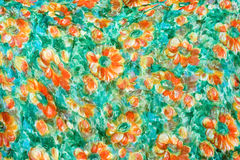 Fragment of colorful retro tapestry textile pattern with handmade floral ornament as background. stock photos