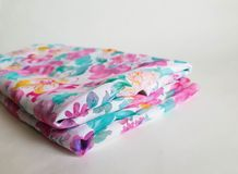 Fragment of colorful transparent textile pattern with floral ornament useful as background or fabric sample royalty free stock images