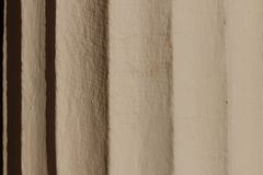Fragment of the column with flutes. Bright sun reveals details. Royalty Free Stock Photography