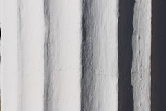 Fragment of the column with flutes. Bright sun reveals details. Royalty Free Stock Photos