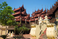 A fragment of the complex of buildings of the ancient teak wood Buddhist monastery Shwe In Bin Kyaung. Mandalay, Burma Stock Photos