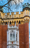 A fragment of a complex of buildings Imperial stables. Peterhof. Tower and window of the building Imperial Stables (1855, architect Benoit). The Palace and Park Stock Photography