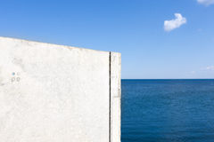 Fragment of the concrete pier near the sea Royalty Free Stock Photography