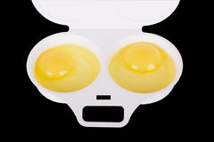 Fragment of a container for egg cooking Stock Photography
