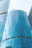 Fragment of contemporary architecture, walls made of glass and concrete. Glass curtain wall of modern office building stock images