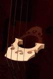 Fragment of a contrabass. A support under strings Royalty Free Stock Image