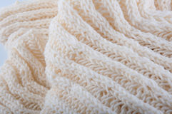 Fragment of creamy handmade wool knitwork. Background Royalty Free Stock Image
