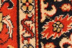 Fragment d'un tapis mongol de laine avec un ornement floral blanc noir Image stock