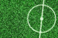 Fragment d'un terrain de football avec un cercle central Photos stock