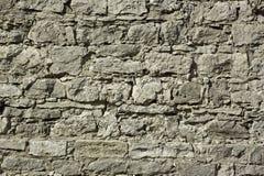Fragment d'une fortification antique de soulagement de mur Photographie stock libre de droits