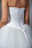 Fragment d'une robe de mariage photographie stock libre de droits