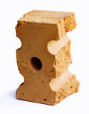 Fragment de brique cassée d'isolement au-dessus du blanc photographie stock