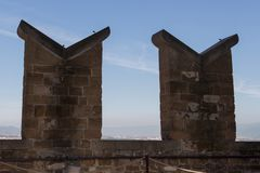 Fragment de dessus de toit de tour de Palazzo Vecchio, Florence, Toscane, Italie Photos libres de droits