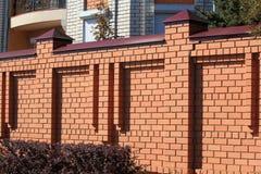 Fragment de la barrière orange de brique Photos stock