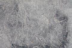 Fragment de la texture en pierre avec des éraflures et des fissures images stock