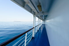 Fragment of deck on ship, ferry with visible blue sea. Stock Photo