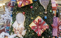 Fragment of decorated Christmas tree in shopping mall royalty free stock photos