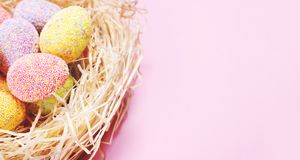Fragment of decorated eggs in a nest stock photos