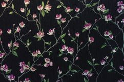 Fragment of a decorative panel with a floral pattern. Floral background for design and decoration. Flowers on a black background stock image
