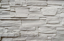 A fragment of a decorative wall made of artificial stone. In the interior of a house Stock Images